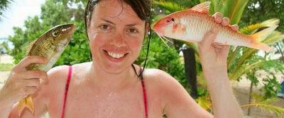 photograph picture of sam breach on the island of Kuata in Fiji with two freshly caught fish
