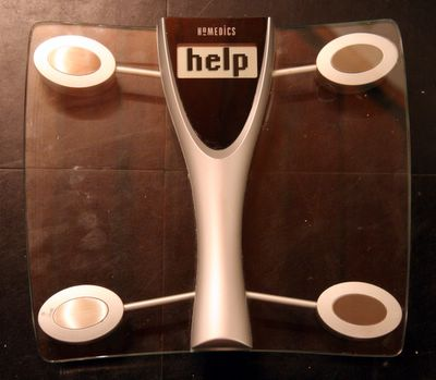 photograph picture of a pair of bathroom scales