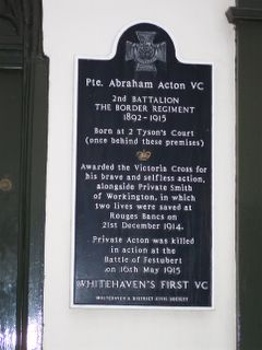 This is the Memorial Plaque at Whitehaven, Cumbria outside the birthplace of Abe Acton VC. In WW1 Abe Acton and another of the West Cumbrian 'pals', Jimmy Smith from the neoghbouring town of Workington were awarded the Victoria Cross for the gallantry at Rouges Bancs, France on 21 December 1914.