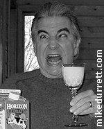 Photo: Mike strikes his King Kong pose and quaffs some milk.