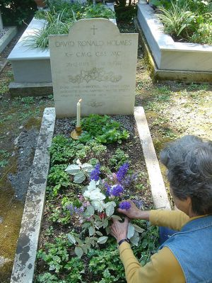 lady holmes arranging flowers at sir ronald's grave on 25th anniversary of his death in corfu
