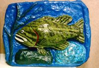 papier mache fish sculpture, by Eric Keast; Broken vulture Art.
