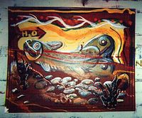 A trout painting on a recyled , framed painting, in the West Bank School of Art, by Eric Keast.