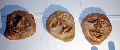 Three versions of a papier mache mask, by Eric Keast; Broken Vulture Art.