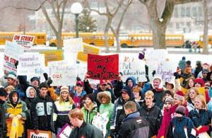 Demanding more money for Minnesota's public schools, nearly 6,000 parents, educators and students gathered at the Capitol steps Monday for one of the largest rallies in recent years. Pioneer Press photo