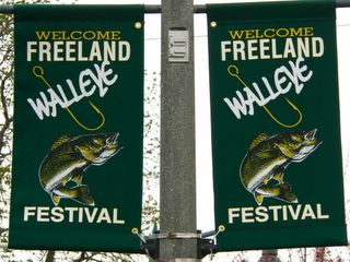 photo of the walleye festival flags in downtown Freeland