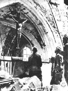 Allied soldiers in the ruins of a church at Lucey-le-Bocage
