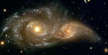 Galáxias Espirais NGC 2207 e IC 2163, pelo telescópio Hubble