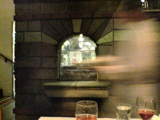 photograph: picture looking through an internal window into the kitchen at Zuni