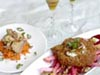 photograph picture of vegan main meal entree Crispy Potato Cake topped with Caramlized Shallots with Horseradish Cream served on top of a Sherry Vinaigrette Salad of Beets, Apples and Walnuts recipes for IMBB#19