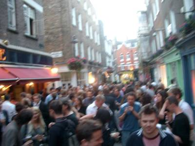 photograph picture of a load of friday night boozers standing outside the white horse on Newburgh Street in Soho London