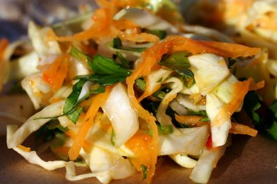 photograph picture of spicy chili coleslaw with cilantro and lime