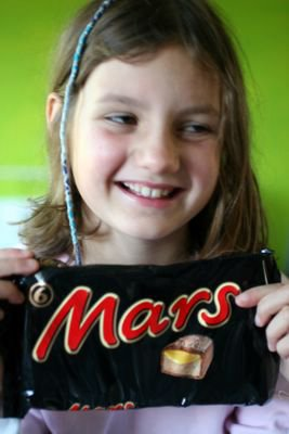 photograph picture of Mollie and a packet of six mars bars