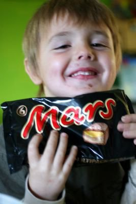 photograph picture of Ben and a packet of six mars bars