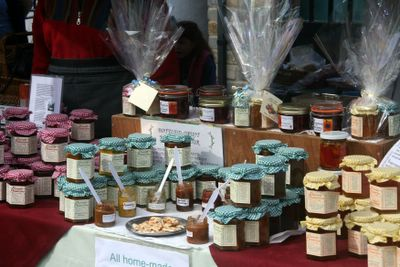 photograph picture of preserves stall at Cheddar Farmers Market, England