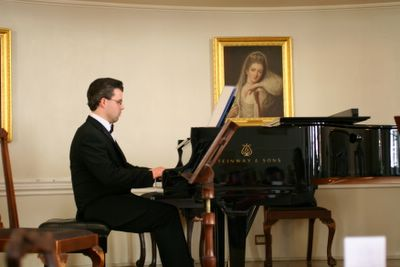 photograph picture of pianist playing at The Pump Room Bath England