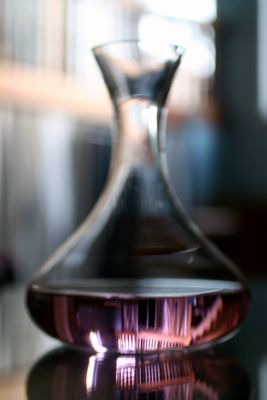 photograph picture of wine decanter filled with faux rose