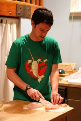 photograph picture of Tim learning to cook chicken tikka masala cutting the chicken