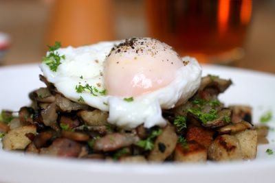photograph picture of poached eggs on a bed of pancetta, shiitake & button mushrooms and croutons?