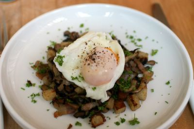 photograph picture of poached eggs on a bed of pancetta, mushrooms and croutons?