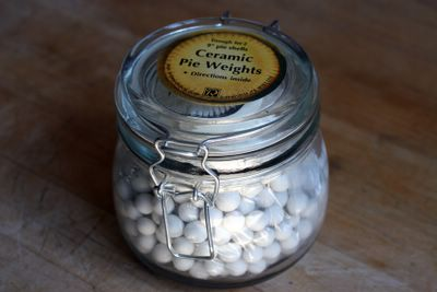 photograph picture of a jar of pie weights $9.95 from Sur La Table
