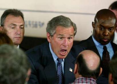George Bush yells at an undecided voter