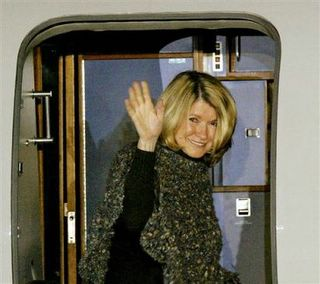 Martha Stewart waves to reporters as she leaves 'Camp Cupcake.'