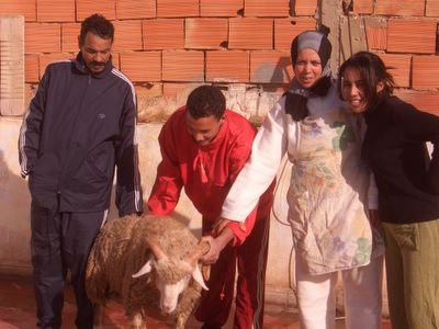 Aid Kbir 2006, family with sheep