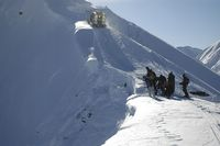 Snowcat climbing ridge at Chatter Creek cat Skiing