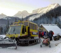 Early Morning Snowcat loading guests at Chatter Creek