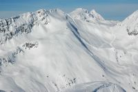 Each cat skiing drainage provides many powder skiing lines