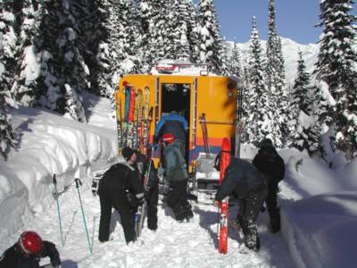 A Bombardier Snowcat with it's Metal Form cab loading Chatter Creek Snowcat Skiers