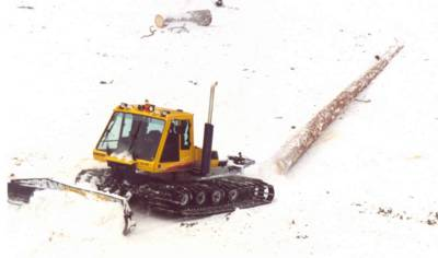A Bombardier Snowcat towing a log