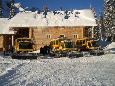 Camoplast / Bombardier Snowcats beside Vertebrae Lodge at Chatter Creek Snowcat Skiing