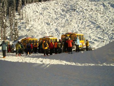 Ski lodge guests loading up for a day of snowcat skiing