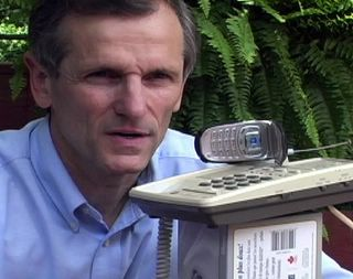 a desktop phone with conference button