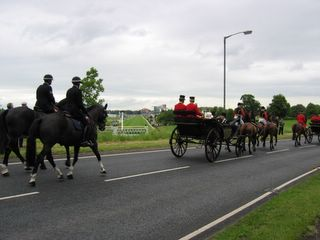 Photo of Royal carriage procession with York Racecourse in the background