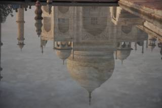 Reflection of the Taj Mahal in one of the pools, at sunset