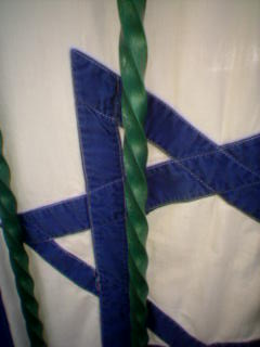 Detail of cotton Israeli flag with stitched-on Stars of David