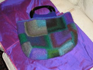 mitered square bag of Noro Kureyon, with purple silk lining material