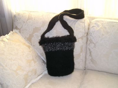 Black felted bucket bag with sparkly, fuzzy trim