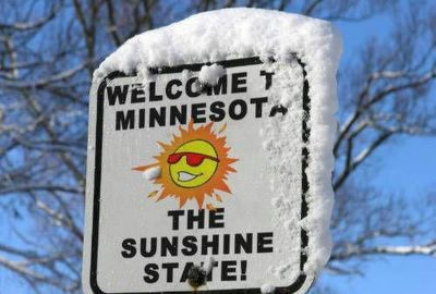 A sign that reads: Welcome to Minnesota - The Sunshine State