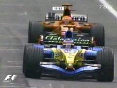 Michael Schumacher fills Fernando Alonso's mirrors with red.
