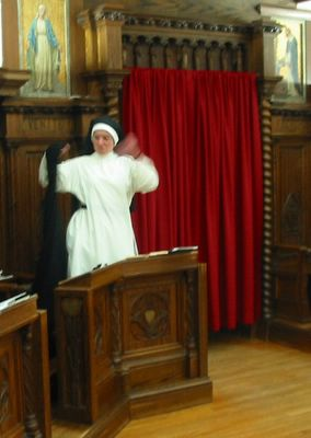 Sr. Mary Martin whips off her cappa at the opening strains of the Gloria.