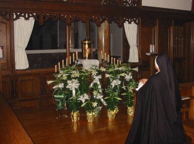 Sr. Maria Concepcion keeps watch with her Divine Spouse at the Altar of Repose which is set up at the choir grille behind the main altar. Sisters will keep vigil the whole night long