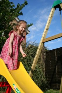 Cousin Chloe taking a leap into the air off the slide