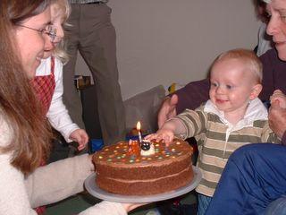 Thomas picking Smarties off his cake