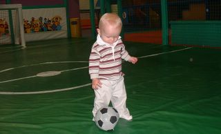 Thomas practising his dribbling