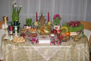 our HaftSin table [1.Seeb (Apple), 2.Sabze (green grass), 3.Serke (vinager), 4.Senjed (a type of berry), 5.Sekke (coin), 6.Seer (garlic), 7.Somagh (Sumac berry)]