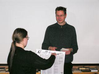 Saija Silvennoinen presenting the Finncon board game to Erkka Leppänen